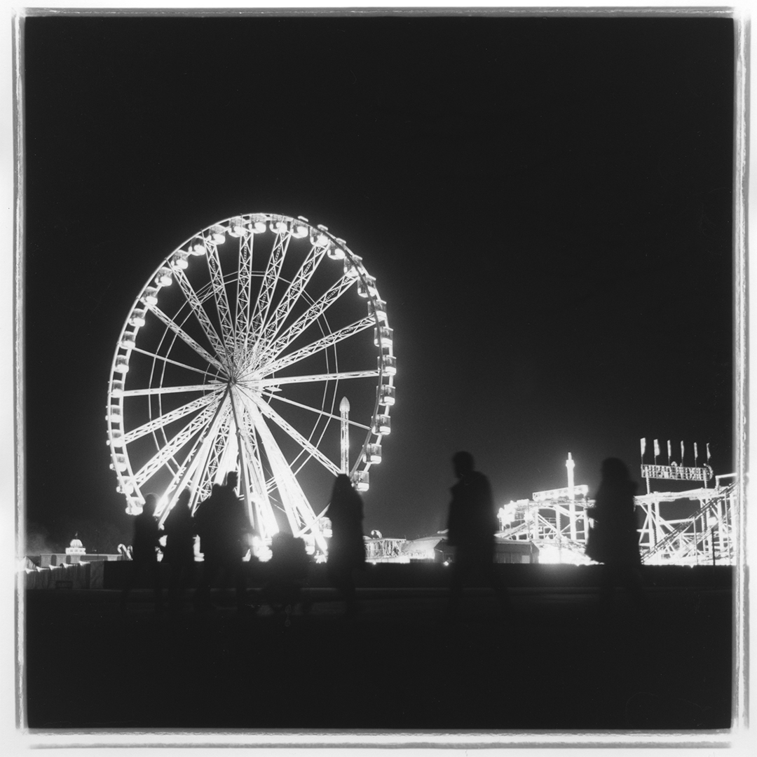 Night photograph showing ghostly images of people walking to the Hyde Park Winter Wonderland during Christmas 2015.  Photographed with a Rolleiflex 2.8e and Ilford HP% 120 film.