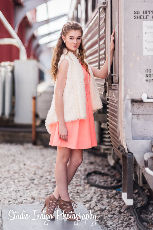 High school junior Sarah on train platform for her Senior Portrait photo shoot.  Pictures shot outdoors with natural light and a small reflector.  Gear used is a Nikon D750 and Nikon 85mm 1.4 D lens.