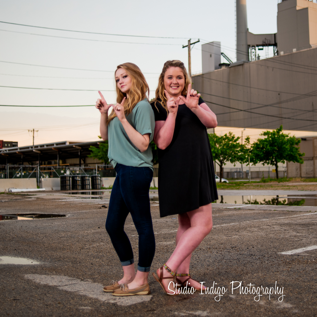 Madison west juniors and best friends Allie and Serena flashing the W during their Friend urban Senior photo shoot in downtown madison, wi.
